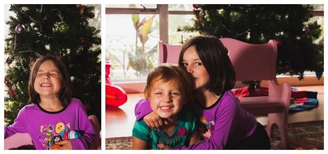 sisters hugging by tree