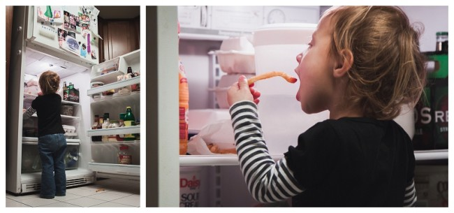 little girl getting into the refridgerator to sneak fries and ketchup