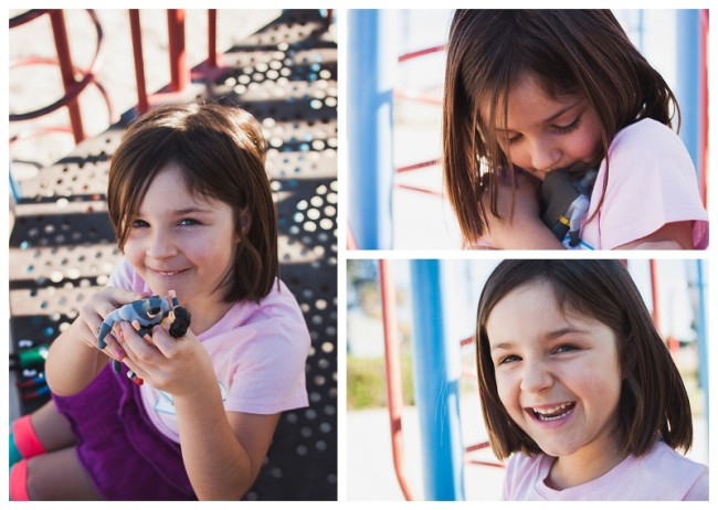 little girl playing with super hero action figures on the playground