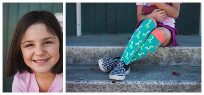 little girl wearing giraffe socks and star wars shoes