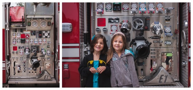 kids standing in front of a fire truck