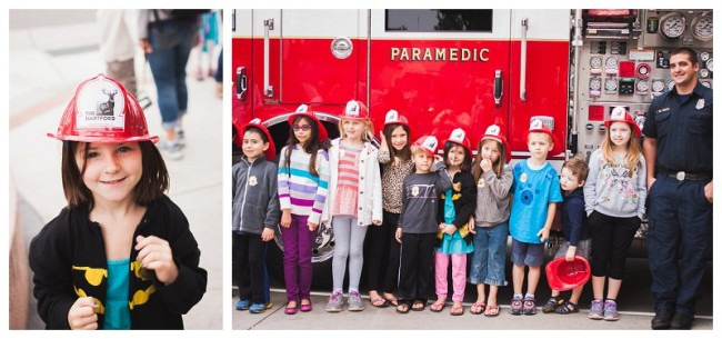 kids in front of a fire truck at a fire station and little girl with fire hat on